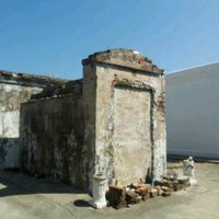 Photo taken at Tomb Of Marie Laveau by Lola G. on 10/8/2012
