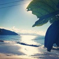 Photo taken at Praia de Laranjeiras by Leandro S. on 5/26/2013