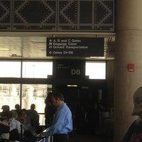 Photo taken at Gate D8 by Timothy L. on 4/5/2013