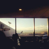Photo taken at Gate 89 by Zach H. on 1/4/2013