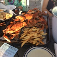 Photo taken at Marina Deck Resturant by Sara S. on 7/11/2014