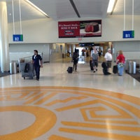 Photo taken at San Antonio International Airport (SAT) by Yvette D. on 7/4/2013