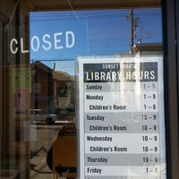 Photo taken at Sunset Branch Library by Bacilio M. on 12/20/2013