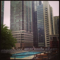 Photo taken at One Superior Place Pool Deck (One W Superior) by Greg D. on 7/31/2013