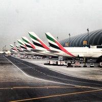 Photo taken at Dubai International Airport (DXB) by Anton E. on 7/14/2013