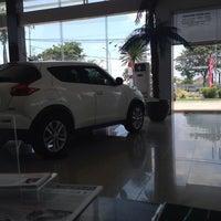 Photo taken at Nissan Arengka by Melati L. on 10/5/2013