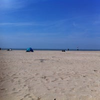 Photo taken at Plage de Deauville by Nicolas G. on 5/26/2013