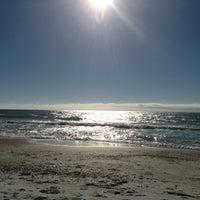 Photo taken at Bradenton Beach by Katie B. on 2/8/2013