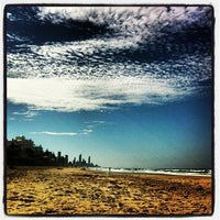 Photo taken at Nobby Beach by Olga T. on 8/31/2013