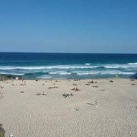 Photo taken at Tamarama Beach by Cemal B. on 10/19/2013