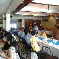 Photo taken at Rustica Restaurant by James G. on 8/10/2014