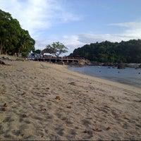 Photo taken at Mutiara Burau Bay Beach Resort by Faizal S. on 12/23/2012