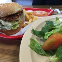 Photo taken at Apollo Burgers by George P. on 3/8/2015