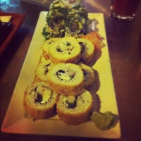 Photo taken at Niu Sushi by Daniela R. on 10/21/2012