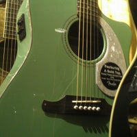 Photo taken at Guitar Center by Erin G. on 12/22/2012