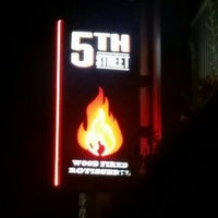 Photo taken at 5th Street Bar & Wood Fired Grill by Zeynep D. on 9/20/2015