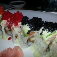 Photo taken at Sushi Zushi by Lisa H. on 12/22/2012