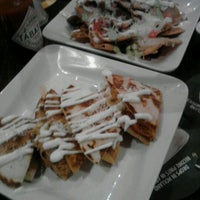 Photo taken at Parrilla Latin Bistro by Rosa S. on 9/25/2012