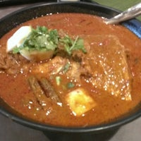 Photo taken at Muthu's Curry Restaurant by Mattew T. on 3/2/2013