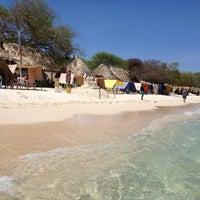 Photo taken at Playa Blanca by Juan Carlos J. on 6/3/2013