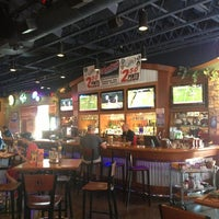 Photo taken at Boston's Restaurant & Sports Bar by Cindy S. on 8/18/2013