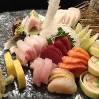Photo taken at Yoshi Sushi by Naomi L. on 12/4/2012