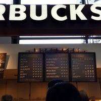 Photo taken at Starbucks Coffee 関西国際空港エアサイド店 by JiNa K. on 7/10/2013