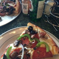 Photo taken at North Beach Pizza by Gabriel M. on 4/30/2014