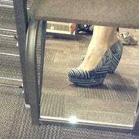 Photo taken at DSW Designer Shoe Warehouse by Honey K. on 3/11/2013