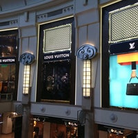 Photo taken at Louis Vuitton by Hugh W. on 9/15/2013
