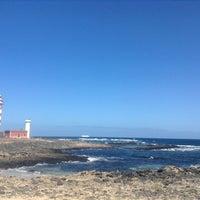 Photo taken at Faro del Tostón by Nauzet on 10/15/2013