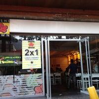 Photo taken at Ikura Sushi-Bar by Katherine G. on 12/17/2012