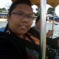 Photo taken at Pantai Pasir Putih by Maria S. on 12/28/2014