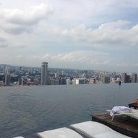 Photo taken at Rooftop Infinity Pool by Karen Leung on 12/7/2012