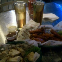 Photo taken at Wings Army by Liz F. on 9/23/2012