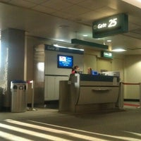 Photo taken at Gate 25 by Saya G. on 9/29/2012