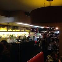 Photo taken at Shine Cafe & Bar by Philip B. on 10/12/2013