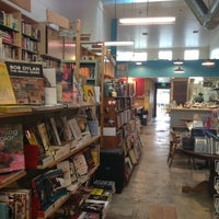 Photo taken at Stories Books & Cafe by Justin I. on 12/2/2012