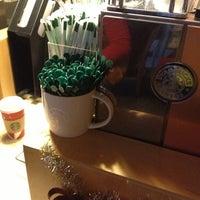 Photo taken at Starbucks by Jevon C. on 12/18/2012
