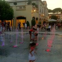 Photo taken at La Reggia Designer Outlet by Vitaliano Massimiliano I. on 7/27/2013