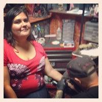 Photo taken at Saint Hillix Tattoo by Jorge L. on 3/20/2014