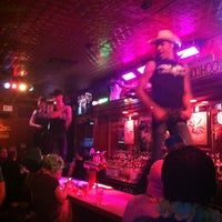 Photo taken at Flaming Saddles Saloon by Brett O. on 3/16/2013