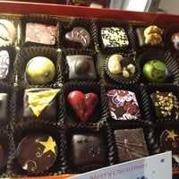 Photo taken at Sweet Paradise Chocolatier by Starla C. on 12/23/2013