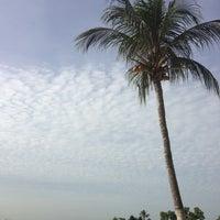 Photo taken at Palawan Beach by Hoe K. on 1/6/2013