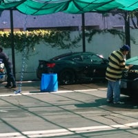 Photo taken at Bob's Hand Car Wash by Cesar V. on 3/8/2014