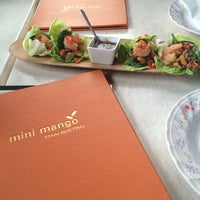 Photo taken at Mini Mango Thai bistro (New name: Mango on main) by Andrea S. on 8/6/2014
