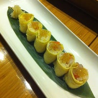 Photo taken at Tojo's Restaurant by Sophia T. on 12/29/2012