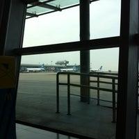 Photo taken at Gate 74 by Yongho L. on 10/13/2013