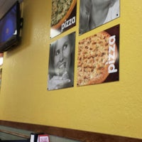Photo taken at Cicis by Kristi D. on 3/4/2014