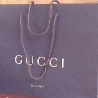 Photo taken at Gucci by Evran D. on 4/11/2013